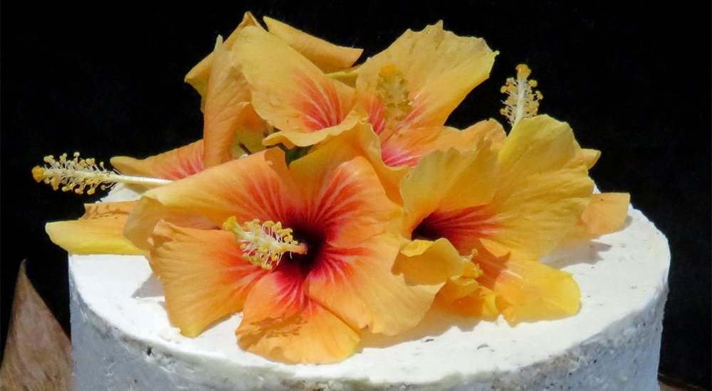 Cake covered in delicious creamy Swiss buttercreams  with natural flowers