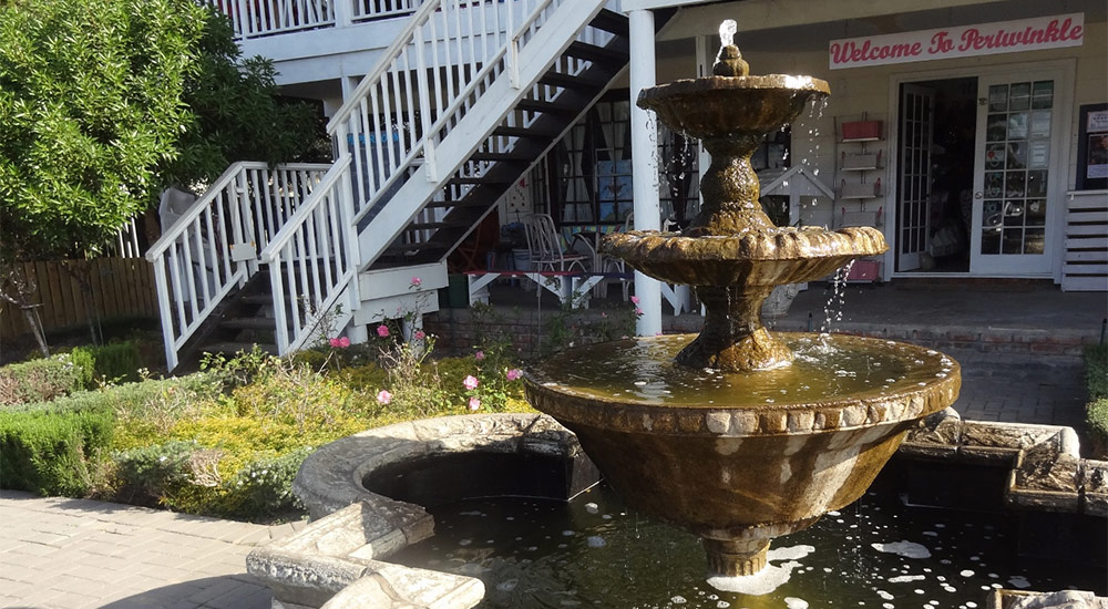 Beautiful water fountain in front of Periwinkle Shop